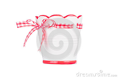 Clay flower pot with red bow Stock Photo