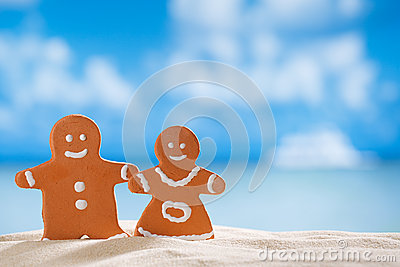 Clay  gingerbread boy and girl on beach
