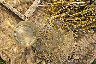 Clay, straw, water and mold for adobe brick