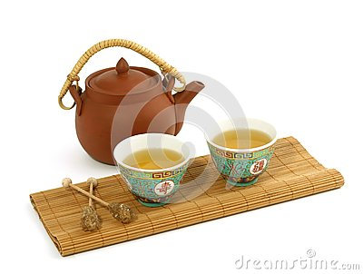 Clay teapot and cups of tea isolated on white