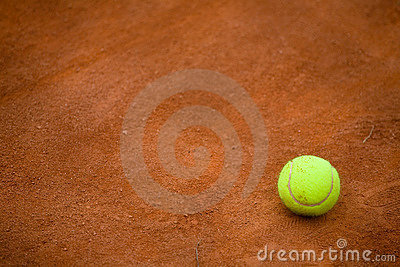 Clay tennis court and tennisball