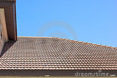 Clay tile roof in florida against clear blue sky
