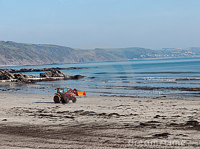 Clean beach digger in action, Looe, Cornwall Editorial Photography