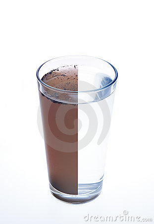 Clean and dirty water in one glass isolated on whi