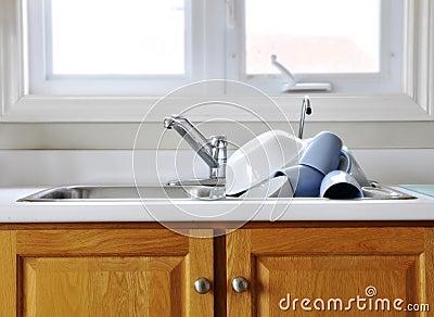 Clean dishes on kitchen sink
