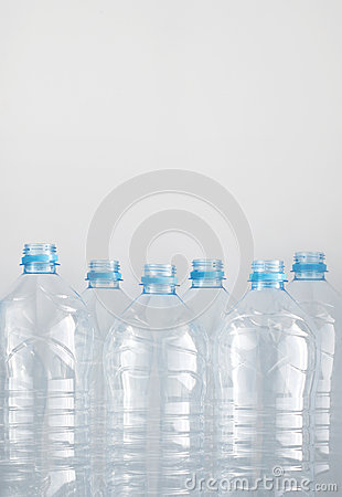 Free Clean Empty Plastic Water Bottles On Table - Recycling And Food Storage Stock Photography - 88847792