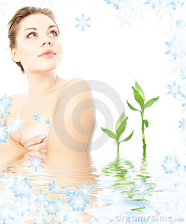 Clean lady in water with green plants