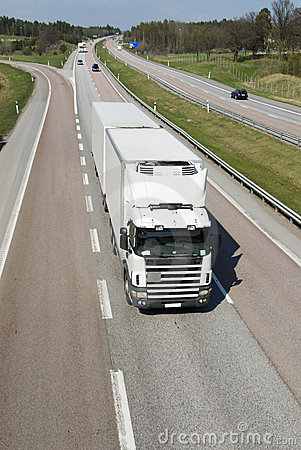 Clean, white lorry on highway