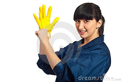 Clean worker female putting latex glove