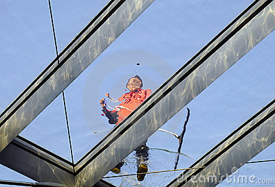 Cleaner working on the skylight
