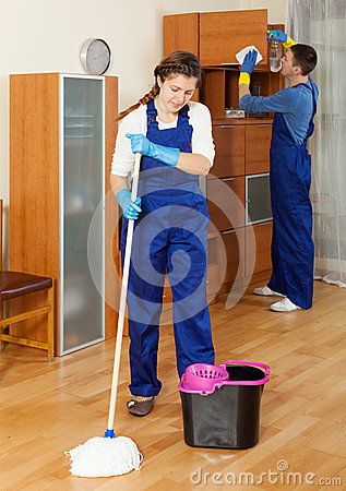 Cleaners cleaning in room