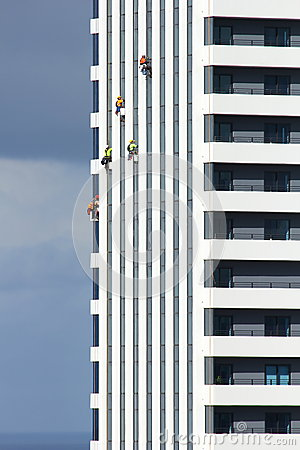 Cleaners hanging on apartment tower Editorial Image