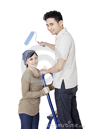 Cleaning couple after moving home