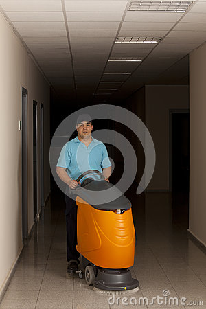 Cleaning floor with big machine at corridor