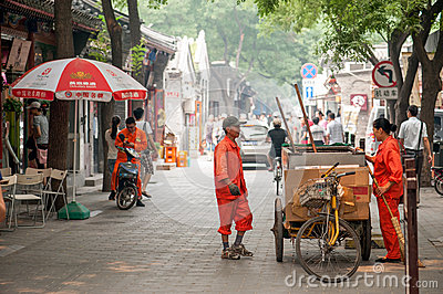 Cleaning the Hutongs of Beijing Editorial Stock Image