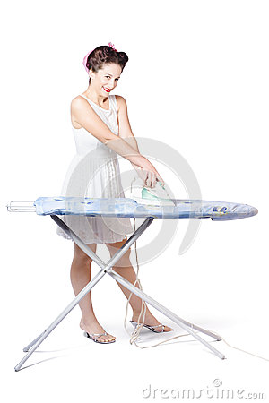 Cleaning lady steam pressing ironing board cover
