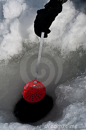 Cleaning out a hole for ice fishing