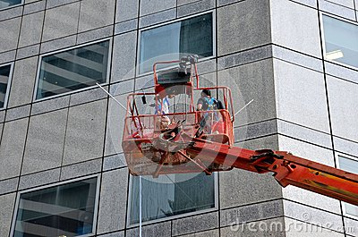 Cleaning skyscraper window and wall from snorkel platform Editorial Photo