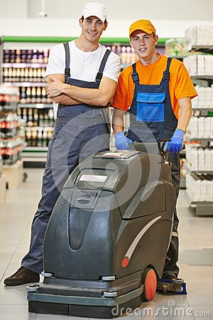 Cleaning team with machine in store