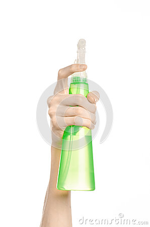 Free Cleaning The House And Cleaner Theme: Man S Hand Holding A Green Spray Bottle For Cleaning Isolated On A White Background Stock Photography - 54991622