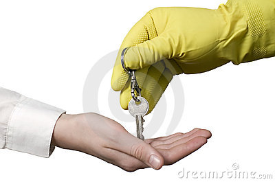 Cleaning worker and key for businessman