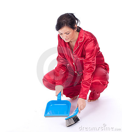 Cleaning young woman in red pajamas