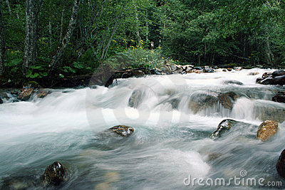 Clear blue mountain falling river waterfall