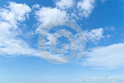 Clear blue sky with white fluffy clouds at noon. Day time. Abstract nature landscape background.  royalty free stock photo