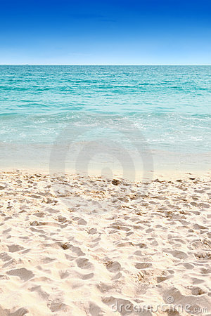 Clear blue water and soft sandy beach