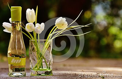 Clear Glass Hugo Bottle With White Flowers Free Public Domain Cc0 Image
