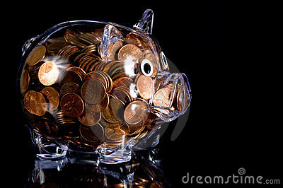 Clear Piggy Bank full of American Pennies