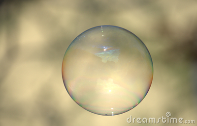 Clear soap bubble on light backdrop