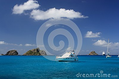 Clear water, island, yachts and boats