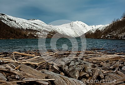Clear water lake in front of a snowy mountain
