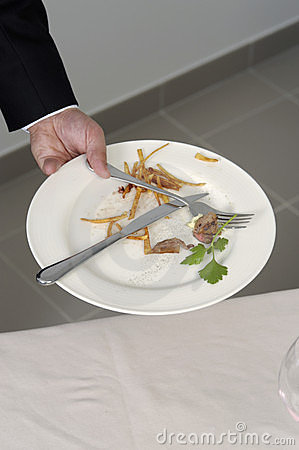 Clearing away the table Editorial Stock Image