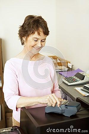 Clerk at Credit Card Terminal
