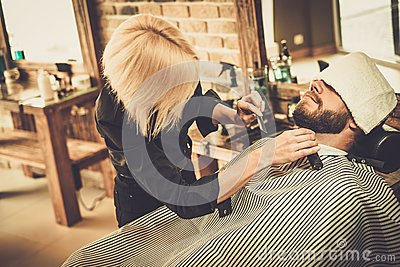 client during beard and moustache grooming stock photo image 56600670. Black Bedroom Furniture Sets. Home Design Ideas