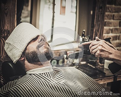 client during beard and moustache grooming stock photo image 63883892. Black Bedroom Furniture Sets. Home Design Ideas