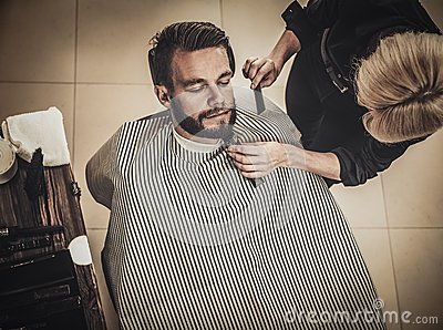 client during beard and moustache grooming stock photo image 63884022. Black Bedroom Furniture Sets. Home Design Ideas