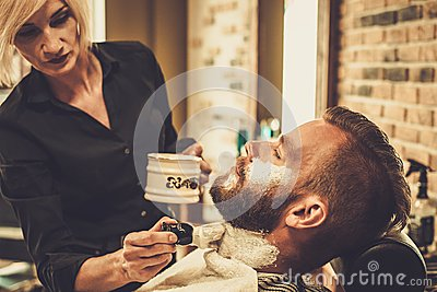 client during beard shaving stock photo image 56600680. Black Bedroom Furniture Sets. Home Design Ideas