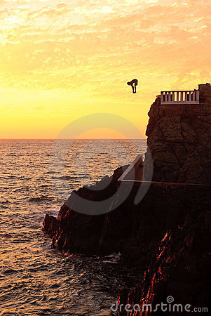 Free Cliff Diver Off The Coast Of Mazatlan At Sunset Royalty Free Stock Photos - 7365998