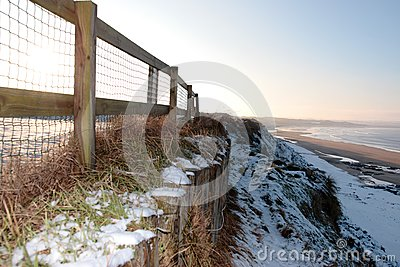 Cliff edge fence over beach