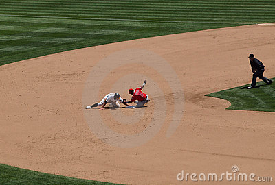 Cliff Pennington slides during steal attempt Editorial Photography