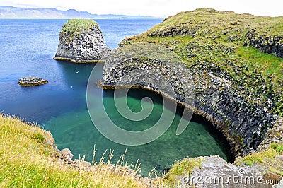 Cliffs and basalt rocks in Arnarstapi, Snaefellsnes peninsula