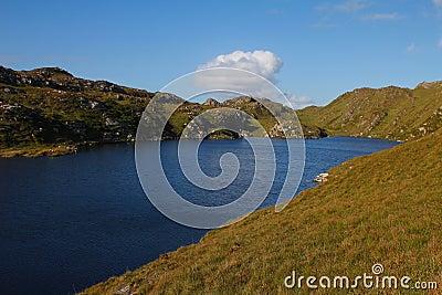 Cliffs and grassy hillside