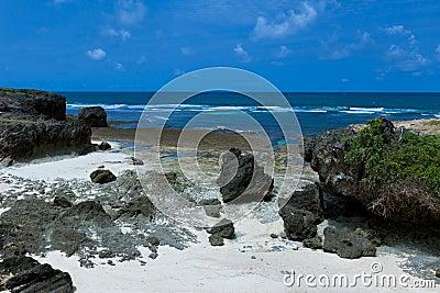 Cliffs at idyllic beach coast holiday paradise