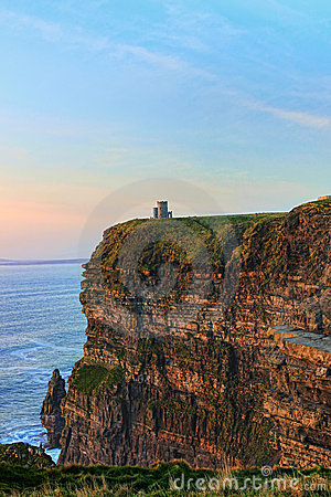 Cliffs of Moher with Tower at sunset in Ireland.