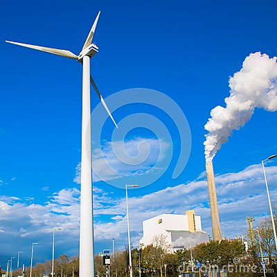 Free Climate Problems. An Electric Windmill And Factory Chimney Royalty Free Stock Photo - 103473575