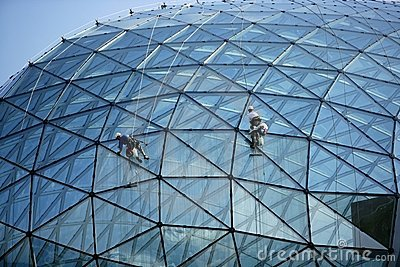 Climber cleaning mirror glass dome building