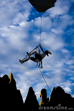 Climber dangling from a rope.